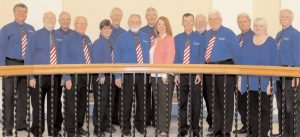 STATE REP. JENNIFER DECHANT, D-Bath, welcomed the Nor'easters Barbershop Chorus of Bath to the State House recently. The group performed the national anthem in the chamber of the House of Representatives at the start of the day's session.