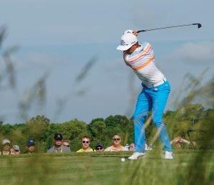 RICKIE FOWLER hits from the 13th tee during the first round of the U.S. Open golf tournament on Thursday at Erin Hills in Erin, Wis.