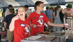 SEAIRA BILODEAU AND ELLIOT DORR have fun while serving up chili and chowder at last year's Chili Chowder Fest. The festival returns to Bath Heritage Days this year.