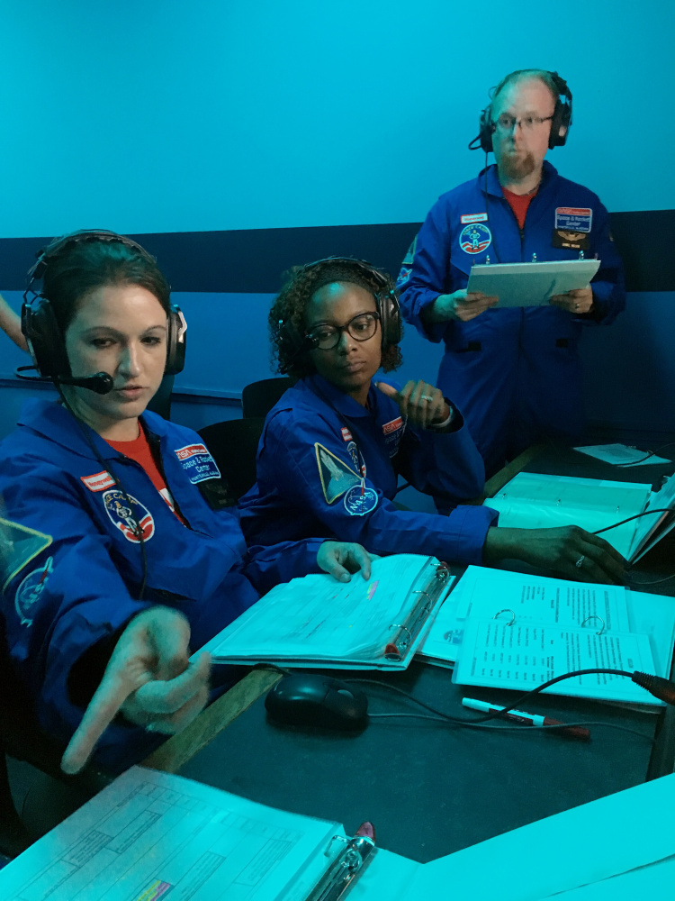 Breanne Desmond, a sixth-grade science teacher at the Vassalboro Community School, takes part in a simulated mission during a one-week program at the Honeywell Educators at Space Academy in Alabama.