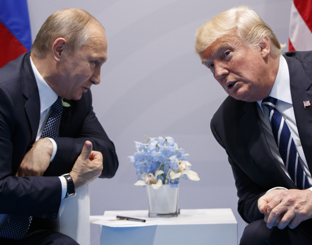 """At their July 2017 meeting at the G20 conference in Hamburg, President Trump says he """"strongly pressed"""" Russian President Vladimir Putin twice about meddling in the 2016 U.S. presidential election, but he didn't say whether he believed Putin's denial."""