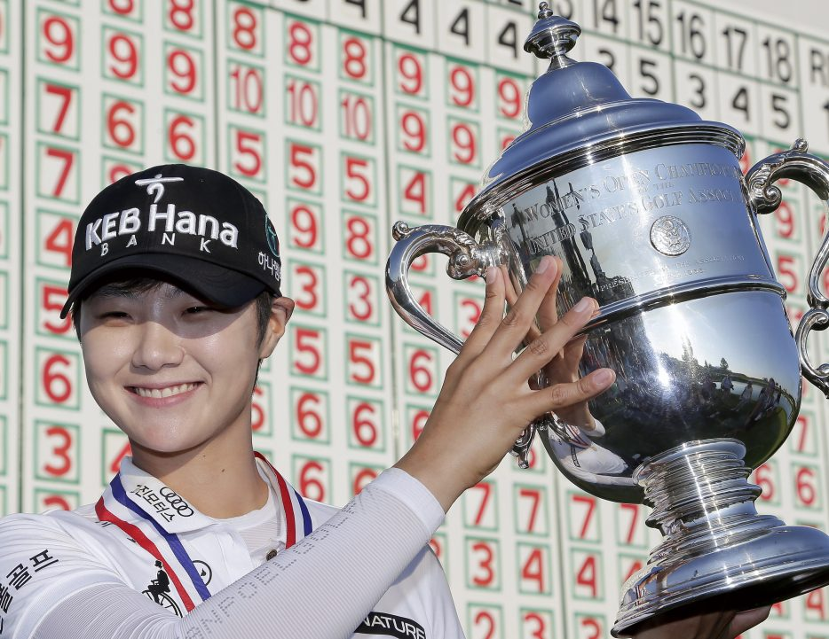 Sung Hyun Park of South Korea holds the championship trophy after winning the U.S. Women's Open on Sunday at Trump National Golf Club in Bedminster, N.J.