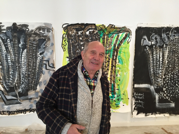 John Walker with some of his works being shown at the Bowdoin College Museum of Art in Brunswick.