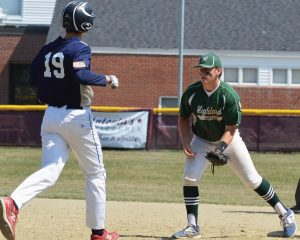 HIGHLAND GREEN first baseman Sam Alexander, right, retires Zone 3 United's Aiden Sweeney (19). Sweeney struck out and tried to reach first after the ball scooted away.
