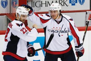 WASHINGTON CAPITALS Kevin Shattenkirk (22) and T.J. Oshie (77) celebrate a goal last season. The two-time defending President's Cup champion Capitals have been forced to make several salary-cap changes this offseason, with Oshie resigning but Shattenkirk joining a growing list of players changing team. Shattenkirk will play for the rival New York Rangers next season.