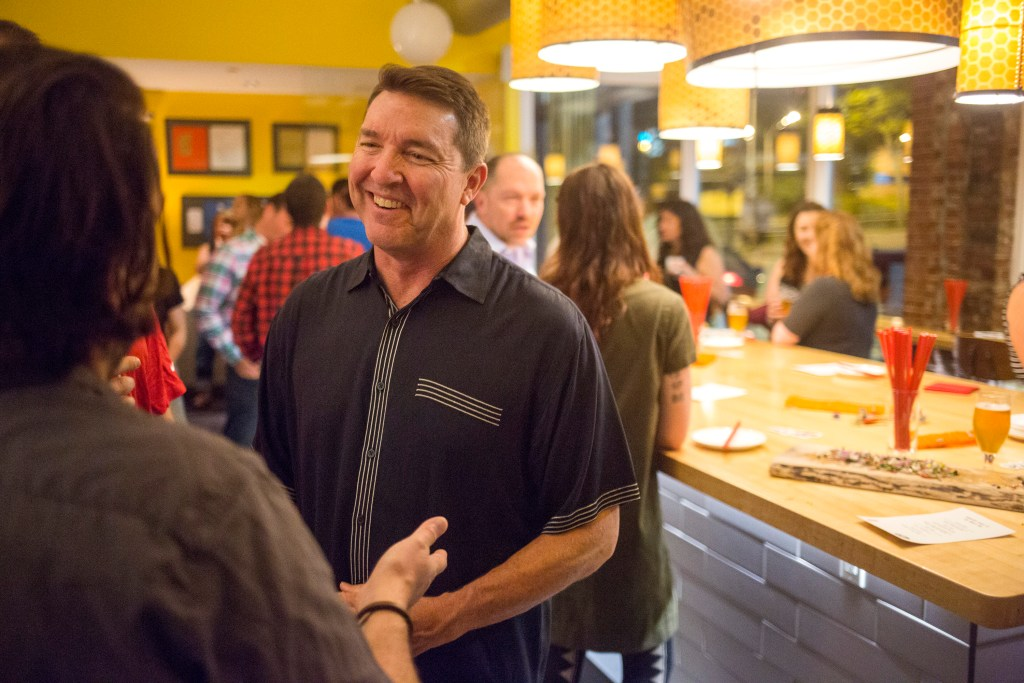 """Matt Jacobson, executive director of the Maine Lobster Marketing Collaborative, talks with San Francisco restaurant owner Stuart Brioza at the """"Maine After Midnight"""" event at the downtown Portland restaurant The Honey Paw on June 12."""