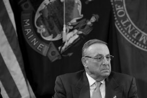 """MAINE GOV. PAUL LEPAGE pauses during a meeting to discuss the state's efforts to fight the opioid epidemic at the State House in Augusta on May 10. LePage urged lawmakers on Sunday, July 2, to put aside """"petty egos"""" and send him a budget as a legislative panel sought common ground on a proposal promoted by House Republicans who torpedoed the previous spending bill."""