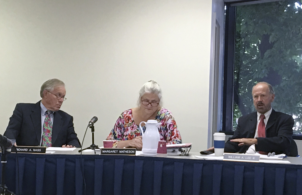 Maine Ethics Commission members, from left, Richard Nass, Margaret Matheson and William Lee discuss the investigation of the financing of the campaign for a York County casino on Thursday in Augusta.