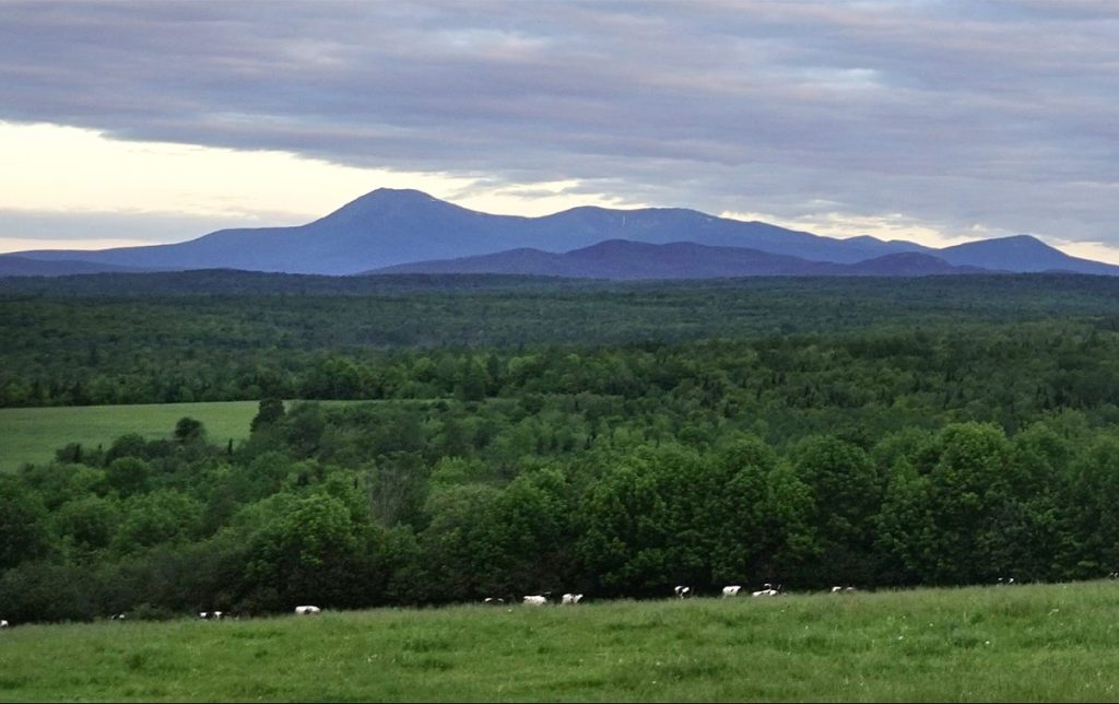 Clouds hang over Mount Katahdin in this photo taken from Route 11 in Patten. Some of the land below the mountain is part of the Katahdin Woods & Waters National Monument.