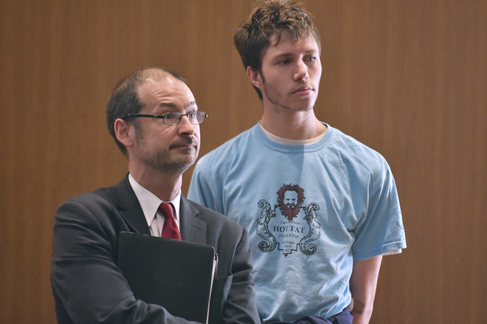 Orion Krause, right, stands with his attorney, Edward Wayland, at Krause's arraignment in Ayer District Court on Sept. 11, 2017. Krause was found competent to stand trial.