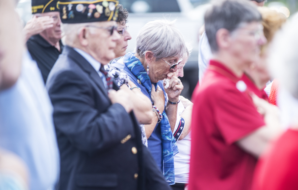Norma Spurling, center, whose brother George Hout disappeared in 1944 on a flight from China to India, gets emotional Friday during an MIA memorial groundbreaking ceremony at the American Legion's Maine headquarters in Winslow.