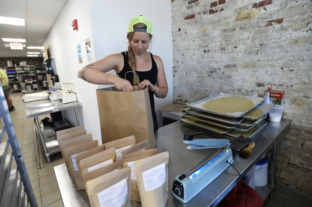 Nina Murray of Mill Cove Baking Co. packages her crackers.