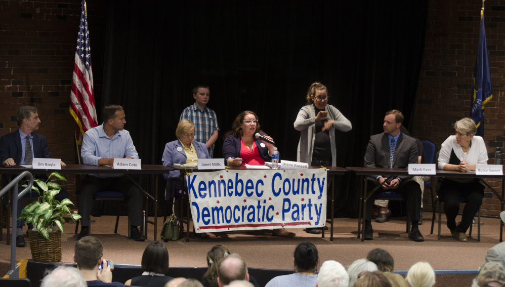 Democratic candidates for governor participate in a forum Thursday night at the University of Maine of Augusta. From left are candidates Jim Boyle, Adam Cote, Janet Mills and Diane Russell; sign language interpreter Paula Matlins; and candidates Mark Eves and Betsy Sweet. More than 120 people attended the event.