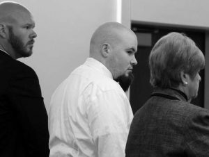 LEROY SMITH III, flanked by lawyers Scott Hess and Pamela Ames, appears in a courtroom on Monday, Sept. 11, 2017, in Augusta, Maine. A judge committed Smith to a psychiatric facility, ending the criminal case against him for the killing and dismemberment of his father.