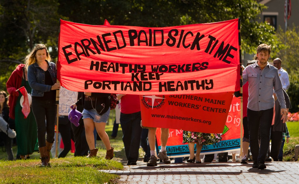 People walk up State Street on Labor Day to launch a campaign for earned sick time in Portland.