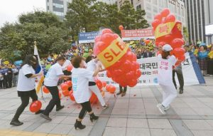 MEMBERS OF KOREA FREEDOM FEDERATION beat balloons symbolizing North Korean weapons during a rally to denounce North Korea's nuclear test in Seoul, South Korea, today. North Korea says it will make the United States pay a heavy price if a proposal Washington is backing to impose the toughest sanctions ever on Pyongyang is approved by the U.N. Security Council this week.