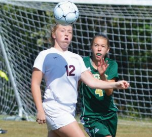 RICHMOND'S ASHLEY BROWN (12) and Rangeley's Olivia Pye (4) have their eyes on the ball during an East-West Conference girls high school soccer game in Richmond on Saturday. Turn to B4 for complete game coverage.