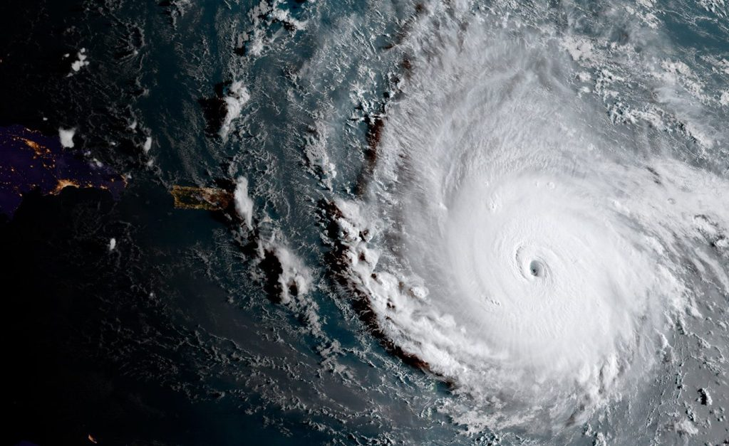 This image released by the National Oceanic and Atmospheric Administration shows Hurricane Irma moving west Tuesday morning toward the Leeward Islands. Irma grew into a Category 5 hurricane, the most powerful in the Atlantic in over a decade, and roared on a path that could take it to the United States.