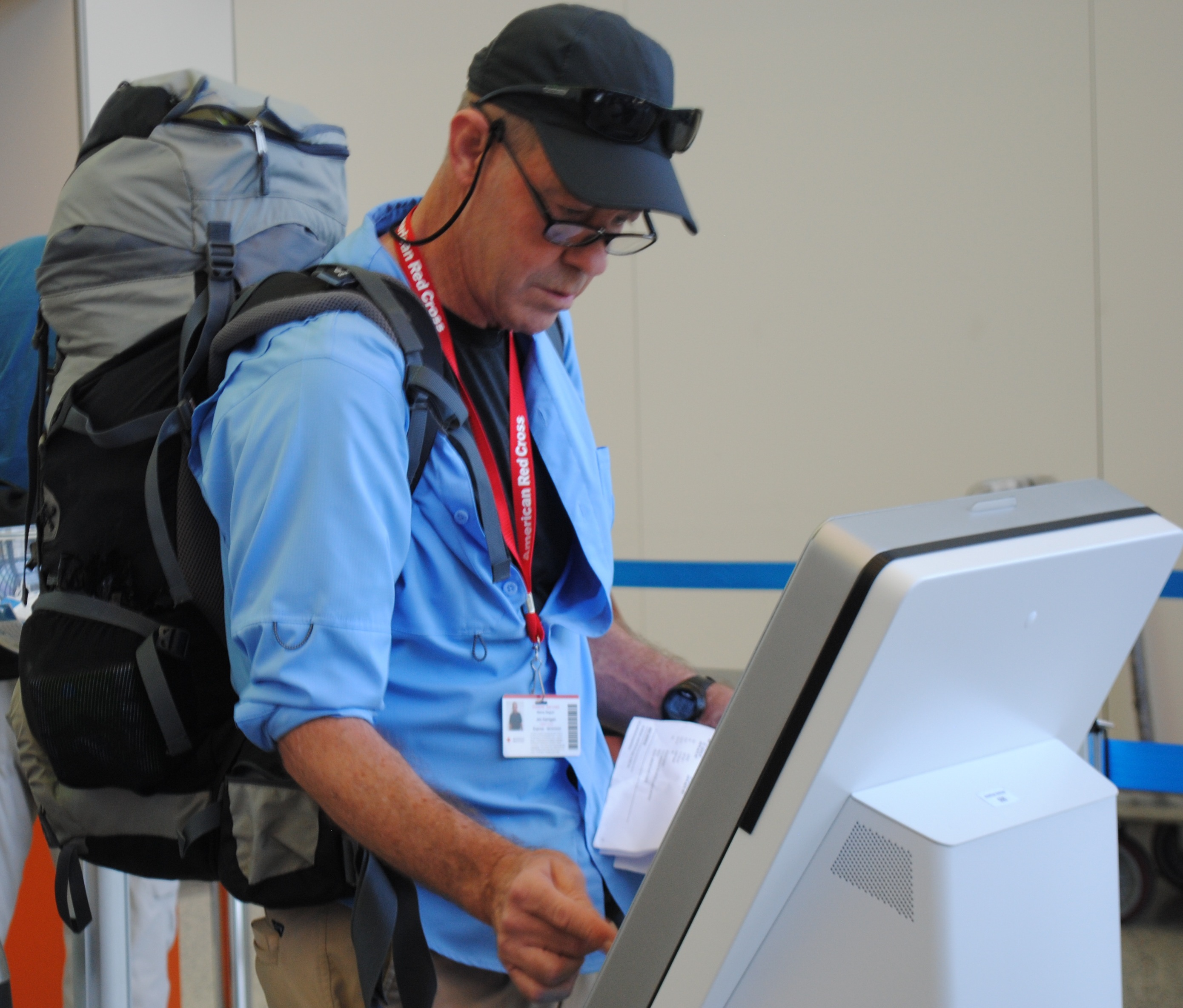 Jim Kerrigan of Old Orchard Beach checks in at the Portland Jetport on Monday morning before deploying to Puerto Rico with the Red Cross.LIZ GOTTHELF/Journal Tribune