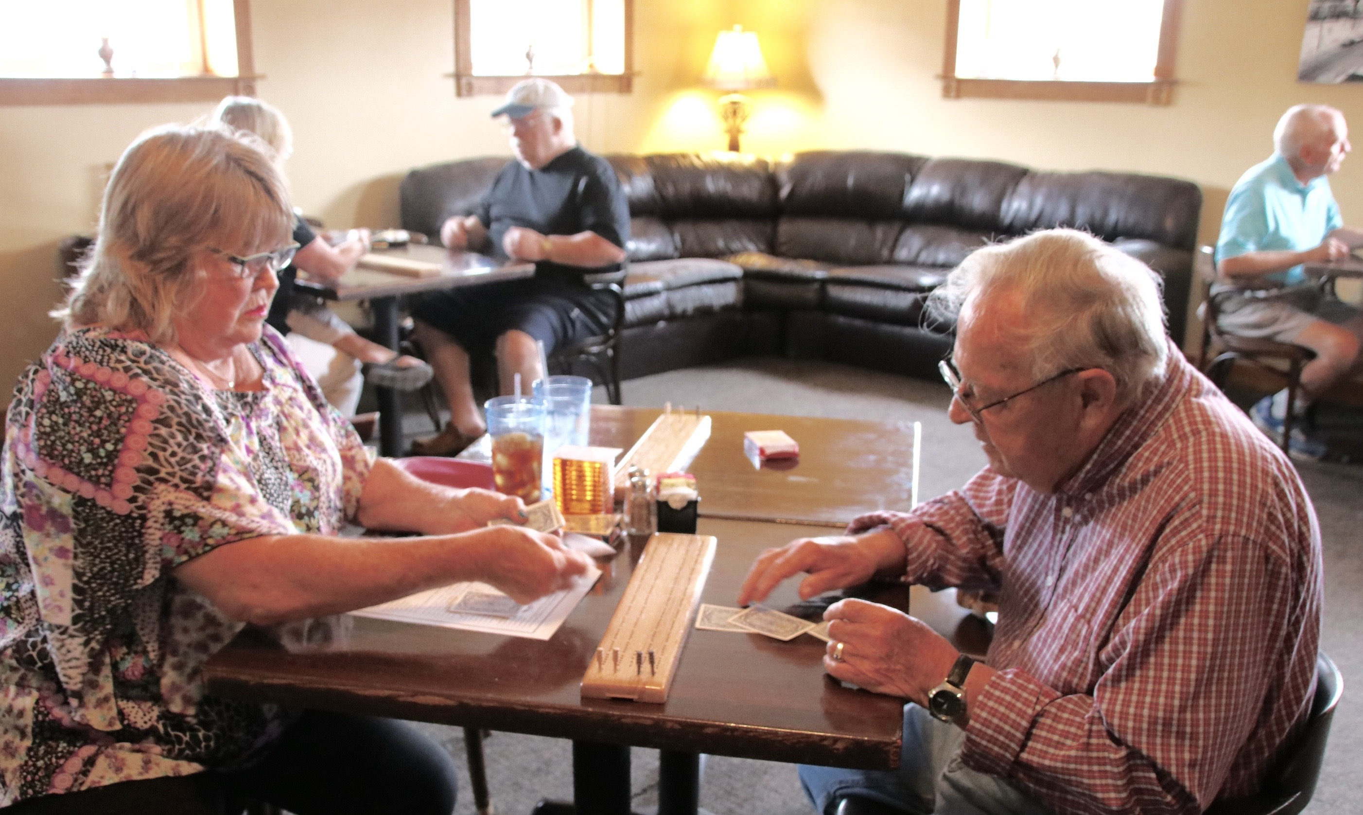 Kathy Messier deals cards for a cribbage game with Joe Hallstrom in the Sanford leg of the Great State of Maine Cribbage Tournament on Saturday at Back Street Grill. This Saturday, folks can take part in another leg of the tourney, at Waterboro Town Hall starting at 8:30 a.m. County and state championships will be held Sept. 30 at Saco Transportation Center. The  tournament benefits MemoryWorks, a non-profit that provides resources for people with dementia. TAMMY WELLS/Journal Tribune