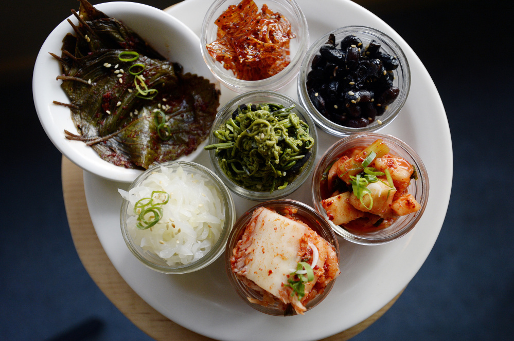 Banchan consists of three small side dishes and accompaniments.