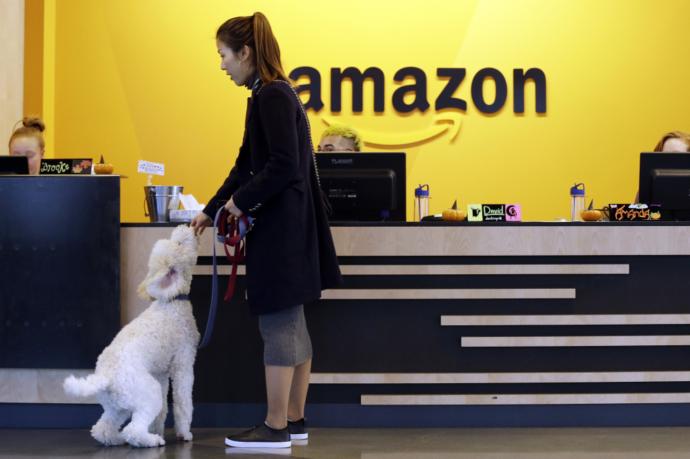 An employee brings her dog into an Amazon building in Seattle where canines are welcome. The company will decide in 2018 where to locate its second headquarters.