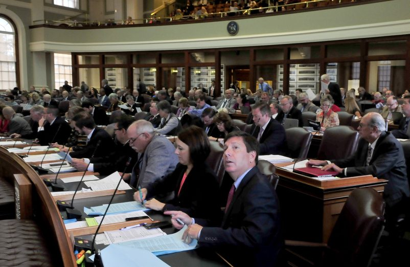 Rep. Kenneth Fredette, R-Newport, looks up at the electronic voting board – which was not working properly – during a special session of the Legislature on Monday.
