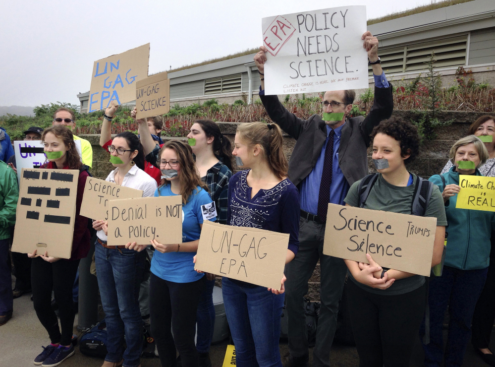 Protesters gather outside a meeting where a report about Narragansett Bay that included the effects of climate change was to be released Monday  in Providence, R.I. The Environmental Protection Agency prevented three of its scientists, who had been expected to discuss the report, from speaking at the event.