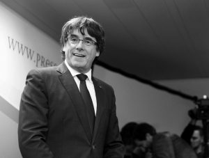 SACKED CATALONIAN PRESIDENT CARLES PUIGDEMONT smiles during a press conference in Brussels, Tuesday. Ousted Catalan President Carles Puigdemont is calling for avoiding violence and says dialogue is a priority during his first address on Belgian soil. Puigdemont on Tuesday recapped the issues which led him to leave for Belgium the previous day, but did not immediately say in his statement what he would do in Brussels or whether he would seek asylum.