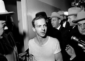 SURROUNDED BY DETECTIVES, Lee Harvey Oswald talks to the media as he is led down a corridor of the Dallas police station for another round of questioning in connection with the assassination of U.S. President John F. Kennedy in 1963. President Donald Trump is caught in a push-pull on new details of Kennedy's assassination, jammed between students of the killing who want every scrap of information and intelligence agencies that are said to be counseling restraint. How that plays out should be known on Oct, when long-secret files are expected to be released.