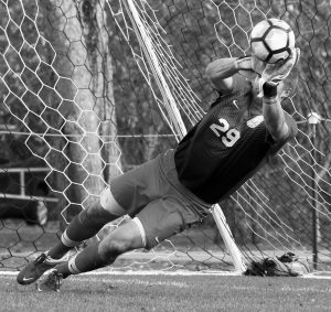 BOWDOIN COLLEGE men's soccer goaltender Stevie Van Siclen makes a save during penalty kicks in a NESCAC quarterfinal against Williams on Saturday in Brunswick.