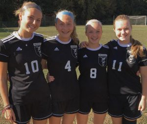 THE BRUNSWICK HIGH SCHOOL girls soccer team features a pair of sisters in its starting lineup. From left are Dragons Isabella Banks, Emma Banks, Sara Scrapchansky and Lea Scrapchansky. The 11-0 Dragons host 10-0-1 Camden Hills tonight at 6 p.m.