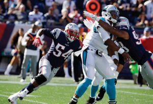 NEW ENGLAND PATRIOTS linebacker Dont'a Hightower (54) pressures Carolina Panthers quarterback Cam Newton in an NFL game at Foxborough, Mass., earlier this season.