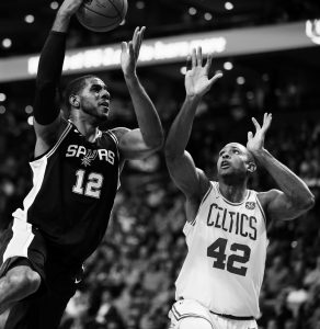 SAN ANTONIO'S LaMarcus Aldridge (12) shoots against Boston's Al Horford (42) during the first quarter of an NBA basketball game in Boston on Monday. The Celtics rolled to a 108-94 victory to improve to 5-2 on the season.
