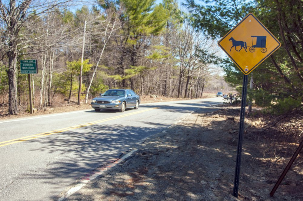 This horse-and-buggy sign, shown in April at Whitefield's municipal boundary with Pittston on Route 194, was one of the early efforts to warn motorists about the slowly moving vehicles.