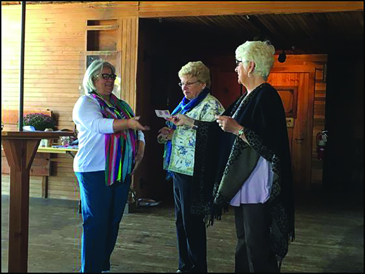Auxiliary Members Carmen Doliber and Suzanne Madore, co-managers of the SMHC Gift Shop, presented Southern Maine Health Care Auxiliary President Denise LaRoche with a check for $20,000 as the Gift Shop's annual donation to the Auxiliary. SUBMITTED PHOTO