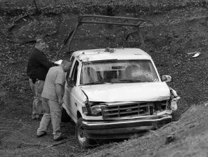 """INVESTIGATORS VIEW A PICKUP TRUCK involved in a deadly shooting at the Rancho Tehama Reserve, near Corning, Calif., Tuesday. A gunman driving stolen vehicles and choosing his targets at random opened fire """"without provocation"""" in the tiny, rural Northern California town Tuesday, killing several people before police shot him dead, authorities said."""