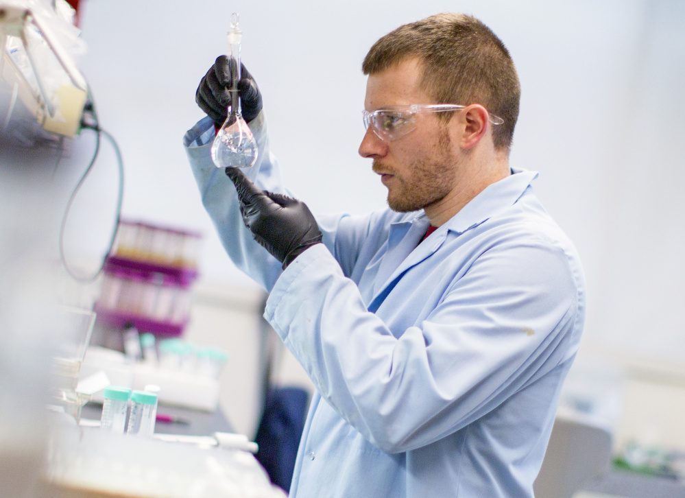 Craig Burnell of Bigelow Labs tests seawater for the presence of amnesic shellfish toxin, caused by a marine bioxtoxin known as domoic acid. If shellfish exceed domoic acid levels of 20 parts per million, a number set by the federal government, state officials must close harvesting.