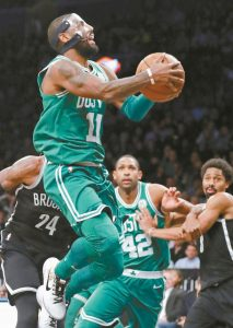 BOSTON CELTICS Kyrie Irving (11) drives to the basket during the second half of an NBA basketball game against the Brooklyn Nets on Tuesday in New York. The Celtics won 109-102.