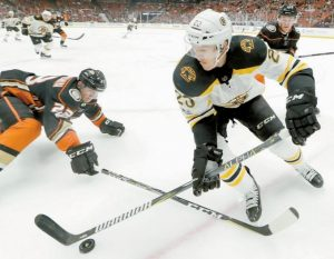 BOSTON BRUINS center Riley Nash battles for the puck with Anaheim Ducks defenseman Francois Beauchemin, left, during the first period of an NHL hockey game in Anaheim, Calif. on Wednesday. The Bruins lost 4-2.