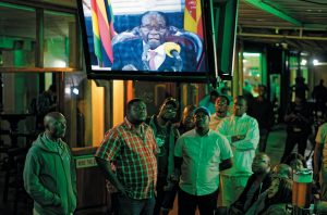 ZIMBABWEANS watch a televised address to the nation by President Robert Mugabe at a bar in downtown Harare, Zimbabwe Sunday. Zimbabwe's President Robert Mugabe has baffled the country by ending his address on national television without announcing his resignation.
