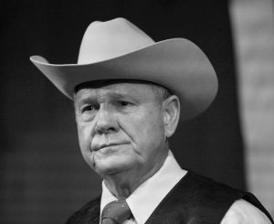 FORMER ALABAMA CHIEF JUSTICE and U.S. Senate candidate Roy Moore speaks at a rally, in Fairhope, Ala. Sept. 25. President Donald Trump in tweets Sunday, Nov. 26, is again coming to the side of Moore by bashing the Democratic nominee Doug Jones in the Alabama Senate race.