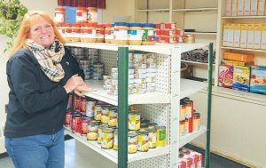 """EXECUTIVE DIRECTOR Kimberly Gates at the Bath Area Food Bank, in this 2016 file photo. """"We lost a lot (from the storm). We lost all of our dairy, all of our eggs. We do have some frozen meats (and non-perishables)."""""""