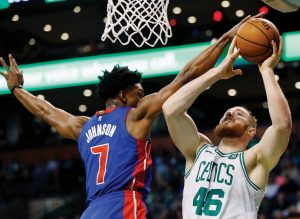 DETROIT'S STANLEY JOHNSON (7) blocks a shot by Boston's Aron Baynes (46) during the first quarter of an NBA basketball game in Boston on Monday. The Pistons handed the Celtics their fourth loss, 118-108.