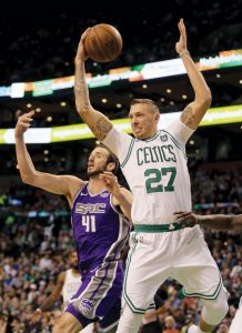 BOSTON CELTICS' Daniel Theis (27) pulls down a rebound ahead of Sacramento's Kosta Koufos (41) during the second half of an NBA basketball game in Boston on Wednesday.
