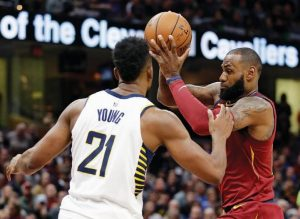 CLEVELAND'S LEBRON JAMES, right, drives against Indiana Pacers' Thaddeus Young in the first half of an NBA basketball game on Wednesday in Cleveland.