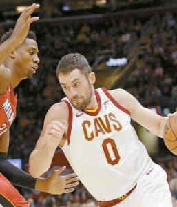 CLEVELAND CAVALIERS' Kevin Love (0) drives against Miami's Hassan Whiteside (21) in the first half of an NBA basketball game on Tuesday in Cleveland. Love dropped 38 points to lead the Cavaliers to a 108-97 win over the Heat.