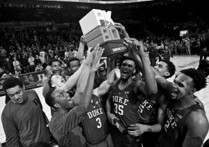 DUKE HOLDS UP the championship trophy after an NCAA college basketball game against Florida in the Phil Knight Invitational tournament in Portland, Ore., on Sunday. Duke won, 87-84.