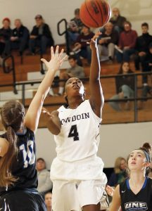 BOWDOIN COLLEGE'S Taylor Choate (4) goes up for a basket during the Polar Bears' 91-59 victory over in-state rival University of New England in Brunswick on Tuesday.