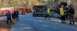 A TRUCK rolled over on Montsweag Road in Woolwich Tuesday morning as it turned off Route 1.